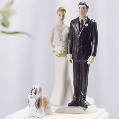 Miniature Terrier Dog Figurines. Now your furry family member can be included on your wedding cake! These adorable canines will look just precious paired alongside any of our Couple Cake Topper Figurines or Mix & Match Bride and Grooms. Choose from a variety of breeds to find the closest fit to your pooch.