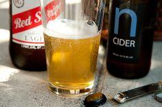 Snakebite•8 ounces hard cider, chilled   •8 ounces lager, chilled   •1/4 ounce black currant liqueur (a.k.a. crème de cassis, optional)