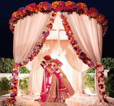 From pastel, floral inspirations to floating mandaps on water bodies, petal-filled setups to bright red, conventional marriage vedis, here are 10 mandap decoration ideas that are on fire. Wedding Ceremony Ideas, Desi Wedding Decor, Wedding Hall Decorations, Marriage Decoration, Wedding Mandap, Wedding Venues, Wedding Photos, Ceremony Programs, Party Wedding