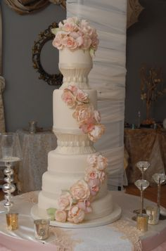 Peonies, garden roses, parrot tulips, moth orchids adorn this stunning wedding cake.