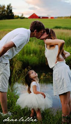 Kissing pose with younger children under. (Will work great for Maternity as well :)