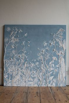 This tile is one of a series from Rachel Deins Tactile Studio. To make the tile, Rachel laid flowers and foliage on to a rolled-out slab of clay and pressed them in to transfer all their details and then carefully removed them. A wooden frame was then placed over and the plaster poured in. Once set, the clay was peeled away to reveal the 'plants' in relief. With this original piece, she made a silicon rubber mould from which this tile was cast - using Crystacal R, a very hard, fine plaster…
