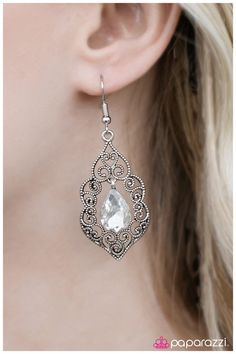 A sparkling white gem is suspended inside an ornate silver frame in a romantic fashion. Earring attaches to a standard fishhook fitting.    Sold as one pair of earrings.