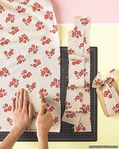 k cutting of fabric for ties, lay it on a mat and use a rotary cutter to cut 2-inch-wide strips. Wrap around bag and tie a