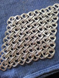 How to Create Chainmail from Pop Tabs: 8 Steps (with Pictures)You can find Pop tabs and more on our website.How to Create Chainmail from Pop Tabs: 8 Steps (with Pictures) Soda Tab Crafts, Can Tab Crafts, Aluminum Can Crafts, Aluminum Cans, Bottle Cap Crafts, Pop Top Crafts, Pop Can Tabs, Soda Can Art, Soda Tabs