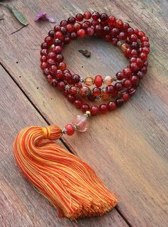 Mala made of 108, 8 mm - 0.315 inch, beautiful faceted agate gemstones and decorated with faceted agate. The guru bead is a faceted cherry quartz stone - look4treasures on Etsy