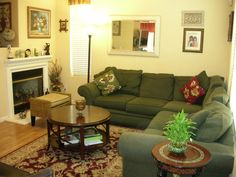 Living Room Minimalist Decorating With Green Sofa Sets Floral Cushion Along Round Wooden Coffee Table Available Fireplace