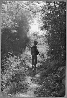 """""""Vietnam . . . A Marine walking point for his unit during Operation Macon, a marine moves slowly, cautious of enemy pitfalls . . .""""  """"Walking point"""" on patrol in Vietnam meant being the first to face ambush, sniper fire, or booby traps. According to one account, this duty meant a man needed to develop a """"sixth sense for danger"""" in order to protect himself and his comrades. 1966"""