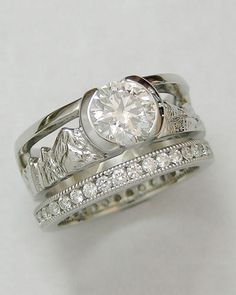 Boulder Mountain engagement rings & wedding rings are available by Cronin Jewelers. Range Rings of Colorado mountains available by Boulder custom jewelers.