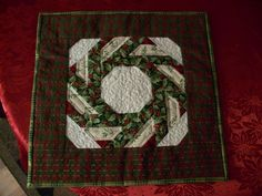 """Whirling Octagon block made into Christmas wallhangings as gifts in 2008. Block was in 1988, Vol. No. 1, magazine """"Fabric special - showcase"""", supplement to Traditional Quiltworks and Quilting Today"""