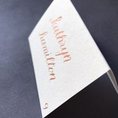 Copper tented place card, wedding and rehearsal dinner, custom calligraphy by KarenLaneCalligraphy   #copper #copperplacecard #fallwedding #autumnwedding #placecard #placecards #escortcard #escortcards #customcalligraphy #customfall #autumnweddingdetails
