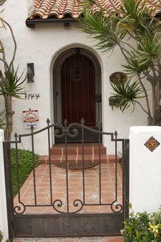 beautiful entry ways ... like this Spanish style house