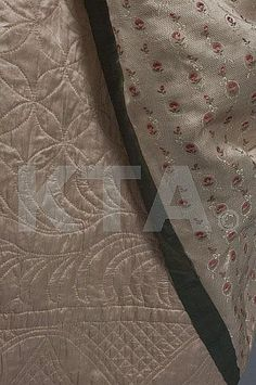 pale quilted pale pink silk petticoat adorned with quatrefoils and scrolls,