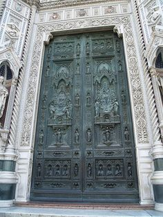 Florence.....the doors of the Duomo are spectacular.