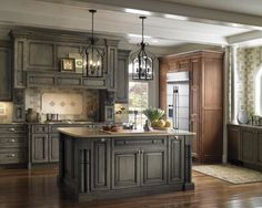 Kitchen & Bathroom Cabinets. I like the chandeliers and the colors of the cabinets