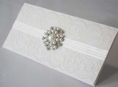Pearl Brooch & lace invitations