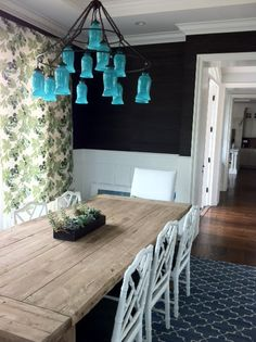 farmhouse style table, great chairs and turquoise chandelier.....totally do-able for WAY less!