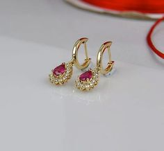 Ct Pear Cut Ruby & Diamond Halo Drop & Dangle Earrings Yellow Gold Over Gold Earrings Designs, Necklace Designs, Gold Jewelry Simple, Diamond Dangle Earrings, India Jewelry, Jewelry Patterns, Designer Earrings, Wedding Jewelry, Engagement Jewellery