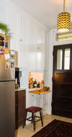 A hidden liquor cabinet?? from Lauren's Bright & Bold Chicago Apartment on #apartmenttherapy