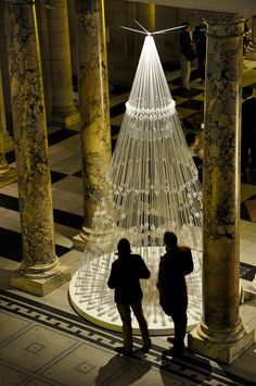 Designed by London-based Studio Roso, the Victoria & Albert Museum's Christmas tree is made from 3.3 miles of elastic cord and stands over four metres high
