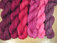Cochineal colours, 1st and 2nd dye baths, with white, grey and fawn yarn - 6 distinct shades.