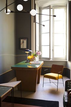 Dimore Studio, Milan | Home study with statement lighting and solid wood shutters