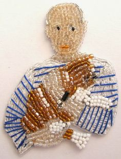 Picasso with cat: brooch by French bead-embroidery maker Marianne Batlle.