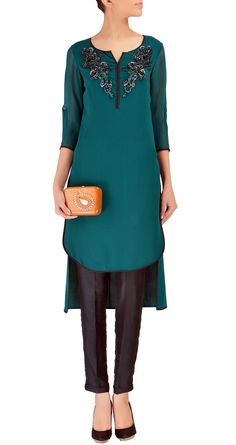 Green asymmetric georgette kurta with embellished neckline. It comes with matching black silk pants available only at Pernia's Pop-Up Shop.