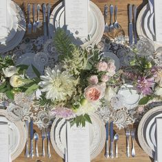 Country wedding tables using fresh flower centrepieces and white plates.  See more at http://coastallifestyle.com.au/table-settings-centrepiece-design/
