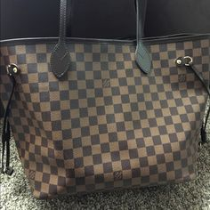 Authentic Louis Vuitton Neverful MM Perfect condition. Barely used. Another listing will contain additional pictures. Price is non negotiable so please don't make low ball offers. I will not accept or respond to them. These bags really don't lose their value and this bag is from a great smoke free home and the bag is in new condition. No flaws or scratches or staining. No trades. X-posted Comes with receipt and dust bag. Thank you! Louis Vuitton Bags Shoulder Bags