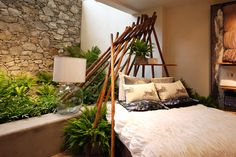 #Anthropologie #Edinburgh love the ferns and pole construct over bed looks somewhere between a teepee or the gunwhales of a boats hull!! Perfect inspiration for awesomizing a boys room!