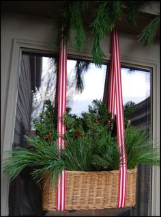 Evergreens in basket window box. Never seen this before. And it's NOT made from a pallet! | outside Christmas decorations