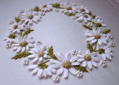http://needlework.craftgossip.com/free-hand-embroidery-pattern-daisy-wreath-2/2012/01/22/