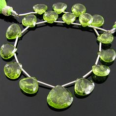 A Grade Heart Shape Peridot Briolettes is originated from Arizona having 17 Pieces of size 10-15 mm in this 8 inch long Strand.      The gemalogical name for peridot is olivine. Jewelry made from peridot is very sought after because of its pretty green color. It comes in many shade of green, from light green to a stunning apple green. It is a very pretty green and is transparent, so any inclusions are more readily seen.