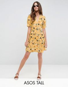 Buy it now. ASOS TALL Tea Dress in Ditsy Floral - Yellow. Tall dress by ASOS TALL, Lightweight fabric, Ditsy floral print, V-neck, Short sleeves, Regular fit - true to size, Machine wash, 100% Polyester, Our model wears a UK 8/EU 36/US 4 and is 180cm/5'11 tall, Mini dress length between: 93-95cm. Find fresh wardrobe wins with our ASOS TALL edit. Raise your sunrise-till-sunset game with occasion dresses, cool separates and jeans that go up to a 38� leg length and are perfectly proportioned…