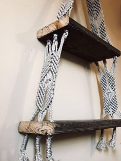 "This shelf is the perfect addition to any room! The detail of the rope blends beautifully with the naturally weathered wood. The top shelf is 14"" and the bottom shelf is 20"". A very elegant and rustic looking modern piece that is sure to draw attention"