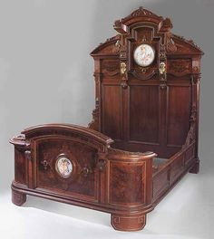 An Important American Renaissance Walnut and Burl Walnut Bedstead, late 19th c., labeled Pottier and Stymus, 375 Lexington Avenue, New York