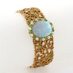 An American Art Nouveau Diamond, White Opal and Demantoid Garnet Plaque Bracelet, c.1900 by Gustav Manz (attributed)