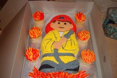 Simple fireman - cake chocolate and cupcakes vanilla. Name spelled out below.