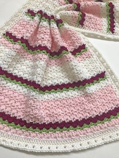 This listing is for a CROCHET PATTERN - Del Mar Baby Blanket - NOT a finished product. This is a sweet, simple and easy to make crochet baby blanket pattern. Shown are two versions, white with blue stripes or pink and white with flowers. The pattern is made with worsted weight