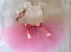 A pretty white singlet embellished with doily flutter sleeves* Tutu and Headpiece Sold Separately