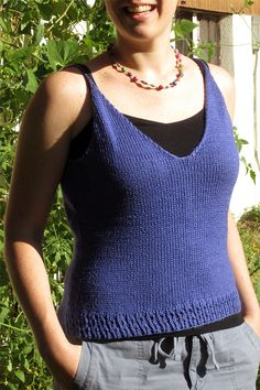 Free Knitting Pattern for Honeymoon Cami - This camisole top is knit with a stockinette body trimmed with a Twisted Rib Eyelet Border. DK weight yarn. To fit bust size 32[34, 36, 38, 40, 42, 44] inches. Designed by Julia Trice for Knitty. Pictured project by Jeannette81