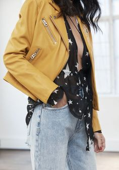 Mustard yellow leather jacket, light wash denim jeans via Dave Wheeler