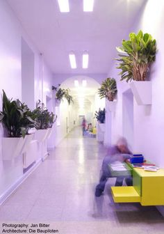 Erika Mann Grundschule, Architect: Baupiloten - The tall, wide corridors of the old school now 'double up' to provide a number of other functions, with built-in, custom-made furniture creating places for individual and small group activities as well as imaginative play.