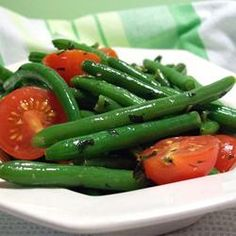 Green Beans with Cherry Tomatoes Allrecipes.com  Very buttery. Great with lemon chicken recipes.