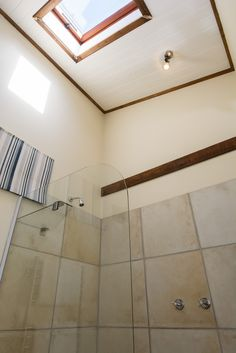 Room 2B:  The skylight brings in natural light in this bathroom.