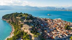 The vibrant Nafplio is a charming city with a spectacular waterfront, small streets and historic buildings crowned by a fortress that looks over another fort in the middle of the harbor. #Nafplio #Peloponnese #Greece #Monterrasol #travel #privatetours #customizedtours #multidaytours #roadtrips #travelwithus #tour #landscape #nature #architecture #sea #beach #sun #sand #mountains #summer #architecture #city #view #green #blue #fortress #castle #beauty #beautiful #thisisgreece Beautiful Places To Visit, Cool Places To Visit, Places To Travel, Travel Destinations, Greece Tours, Greece Travel, Santorini, Mykonos Greece, Crete Greece
