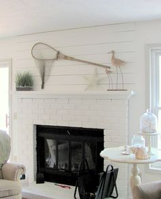 Mantel Planks--Add a beachy look to a regular sheet rock walls house, by adding a couple planks above the mantel