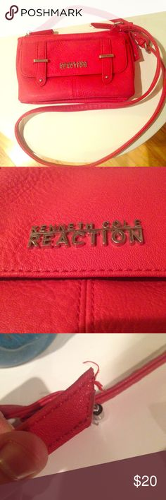✨SALE✨Red Leather Kenneth Cole Crossbody Gorgeous red leather crossbody. Shows very slight signs of wear, but hadn't been used a lot and was cared for. Faux leather. Please make me an offer!! ✨FALL SALE ✨ - all reasonable offers will be accepted and will include a free gift! Kenneth Cole Reaction Bags Crossbody Bags