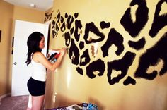 CHEETAH PRINT WALLS!! Was planning on doing zebra print in the big kid's closet doors, but she is cat-obsessed. She may prefer this.